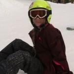 Maggie-Bee snowboard sitting
